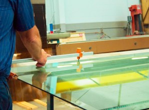 Glass workers measuring glass