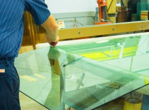 Glass workers fitting glass